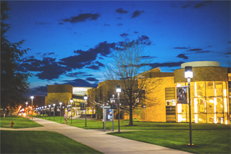 Photo of campus buildings in the evening